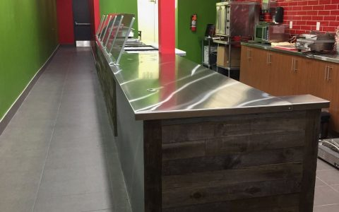 Polished stainless steel countertops, foot plate and cladding