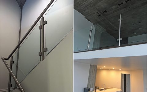 Polished stainless steel handrail and posts with glass
